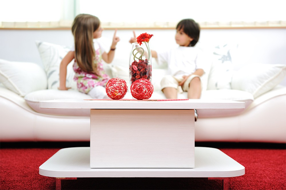 Little brother and sister at  home with modern furniture
